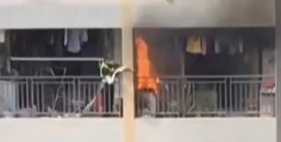 佛山:高层住户突发火灾 疑是烟头惹的祸