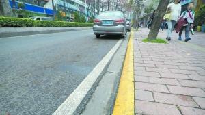 广州首次启用禁停标线 路边黄线莫停车否则罚200元扣3分
