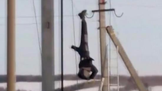 危险!俄电工高空作业时触电 倒挂逾1小时获救