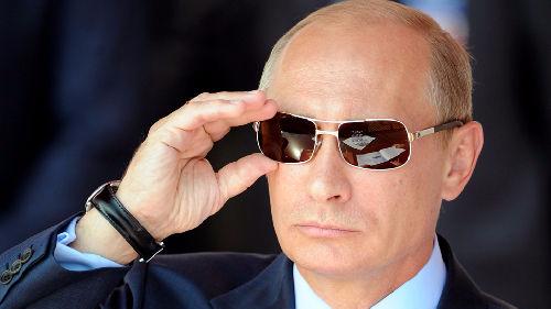 """对外强势取分成绩单""""给力"""" 普京谋求连任"""