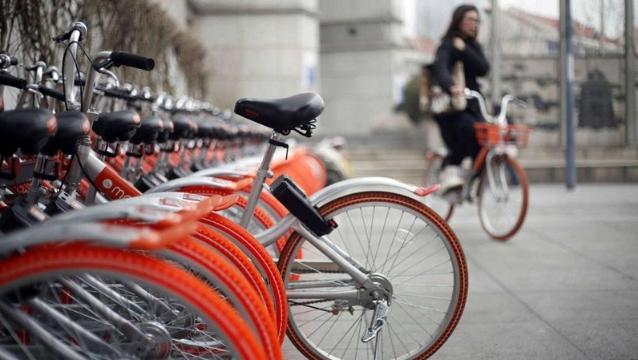 20万辆共享单车被套上车座广告 摩拜单车索赔100万元