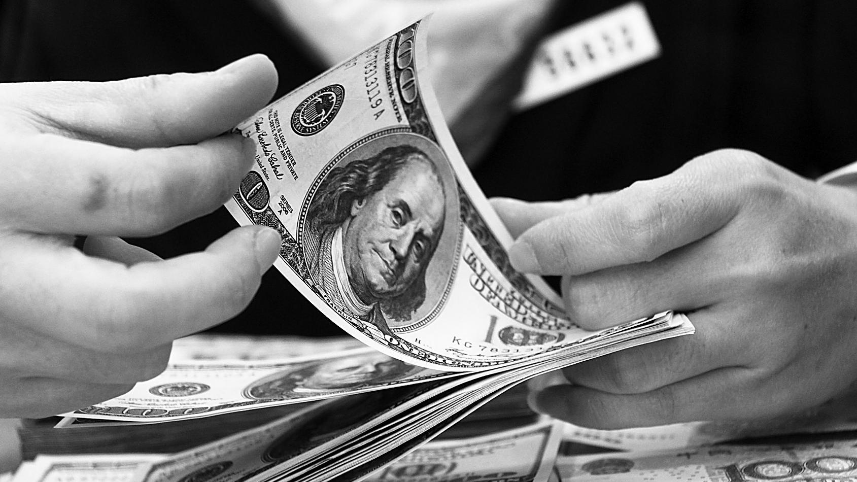 人民币对美元汇率中间价报6.4401 下调66个基点