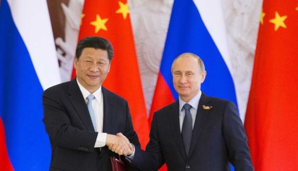 同俄罗斯总统普京分别向中俄地方合作交流年开