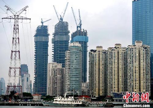 资料图:正在建设的楼盘。<a target='_blank' href='http://www.chinanews.com/'>中新社</a>记者 张斌 摄
