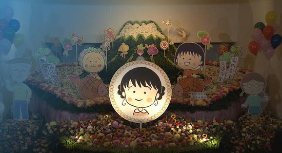 樱桃小丸子作者告别仪式举行 摆自画像当遗像