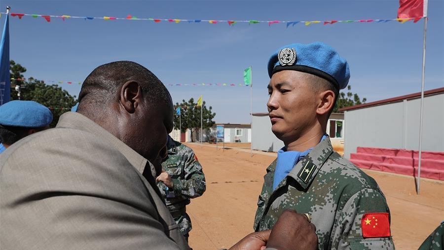 """中国一支维和工兵分队全部官兵获联合国""""和平荣誉""""勋章"""