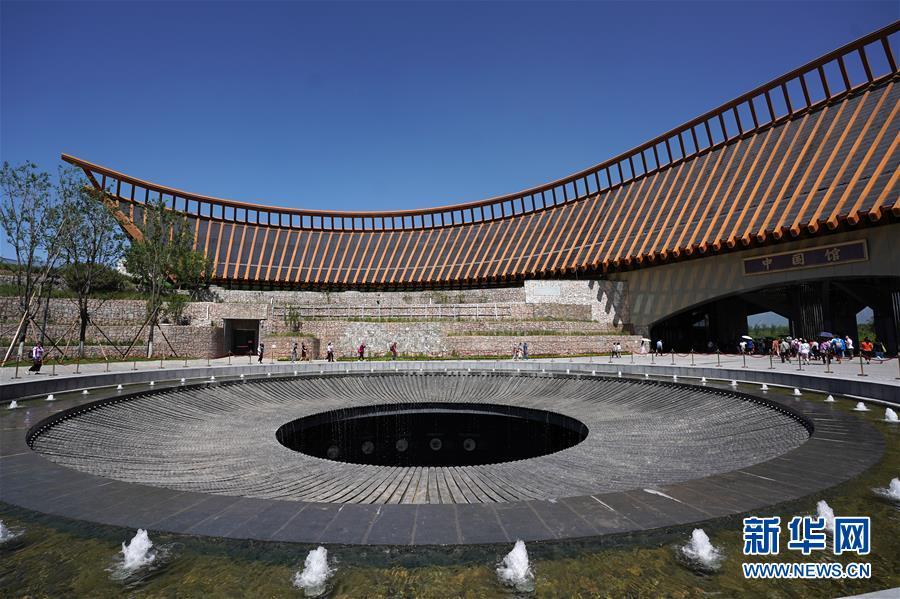 """(在习近平新时代中国特色社会主义思想指引下——新时代新作为新篇章·图文互动)(3)从世园会""""看""""中国绿色发展之路——写在北京世园会""""中国国家馆日""""到来之际"""